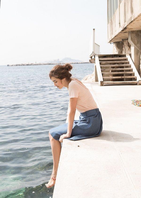 Blush t-shirt, blue midi skirt, tan embellished sandals seaside