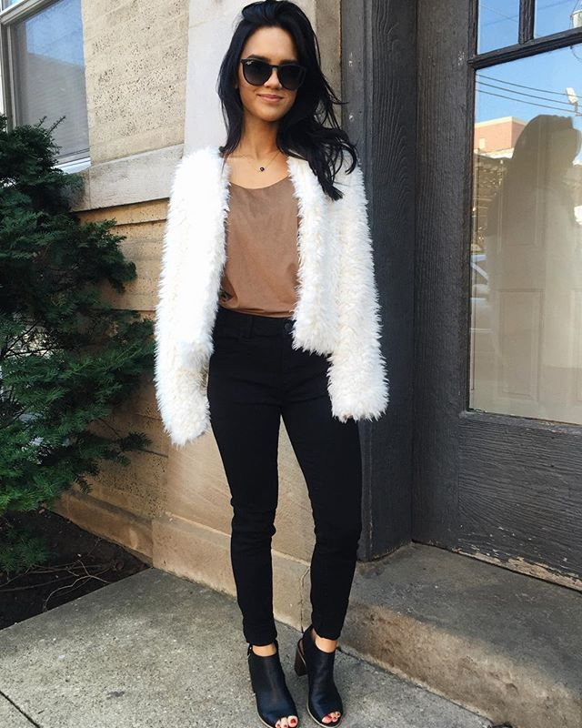 Dacey hapa outfit and style, white fur jacket, tan suede cami, black skinny jeans, open toe black boot sandals