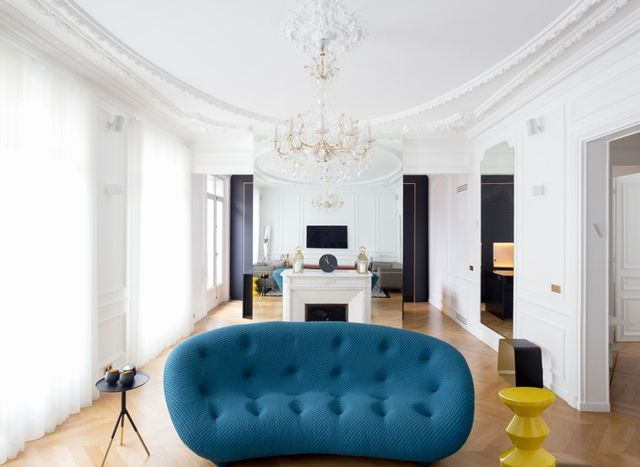 The ceiling moldings and modern furniture are a perfect compliment to one another