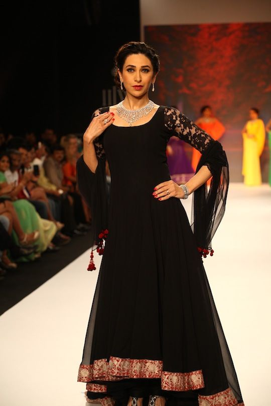 Karisma Kapoor in a black Manish Malhotra Anarkali ensemble wearing a gleaming diamond set on Day 4 of India International Jewellery Week 2013. #Bollywood #Fashion