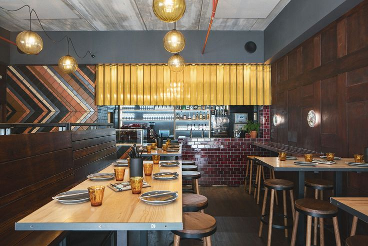 Artwok Eatery - a contemporary, vibrant space in Takapuna. Custom made Bar area with Gold zig-zag feature bulkhead along with the waiter stations with the same gold feature.