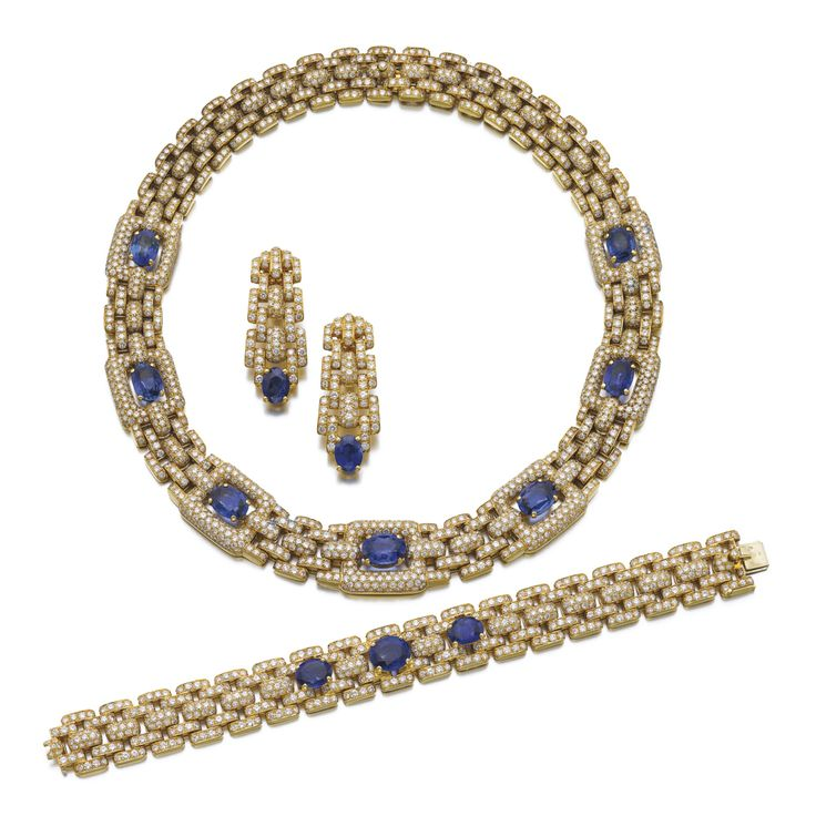 Sapphire and diamond parure, 'Maillon Panthère', CartierComprising: a necklace composed of pavé-set brilliant-cut diamond links, the front set with oval sapphires, length approximately 375mm, a bracelet, length approximately 185mm, and a pair of ear clips, each signed Cartier, numbered, French assay and maker's marks, fitted case signed Cartier.