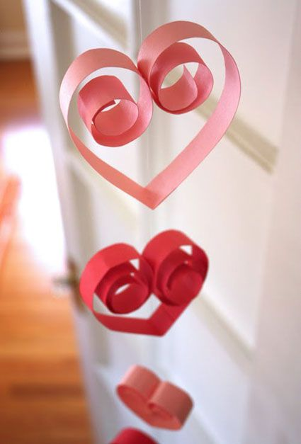 take a strip of paper wrap one end around the pencil hold for 30 seconds then do the same on the other side. once both sides are curled place a piece of tape to stick the curls together hang with string, simple yet fun for kids