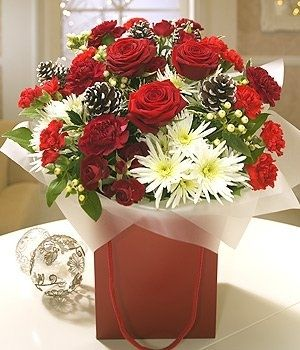 Florists sell hand ties in vases or bags at Christmas. Customers buy these as gifts or thank you's at Christmas time. These can average at £35, depending on how large they are.