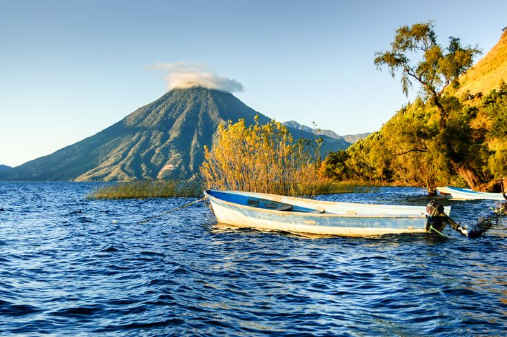 A breathtaking lake framed not by one but three vertiginous volcanoes, Lake Atitlan is nestled in the mountains of northern Guatemala and surrounded by gorgeous ethnic villages.