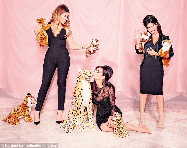 Purr-fect: The sisters have worked together on several collections for the brand before, and are skilled at posing up a storm in their self-designed items... along with cuddly cats