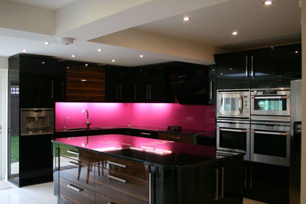 black kitchen pink splashback! I always said my next house will have a pink and black kitchen to match my pink kitchenaid mixer! ;)