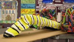 Giant caterpillar from a pool noodle and paper plates