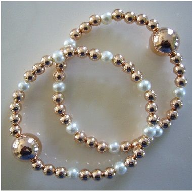 """Queasy Beads™ Motion Sickness Bracelets in """"Radiant Rose Gold"""" designed using rose gold beads and pearly white glass beads.  Queasy Beads™ are natural nausea relief bracelets for motion sickness, carsickness, seasickness, morning sickness, anxiety, migraine nausea, vertigo and more!"""