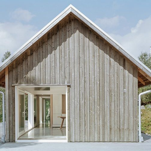 Stockholm-based practice Mikael Bergquist Architects have designed a vacation house in northern Bohuslän, Sweden. The exterior of the house is clad with untreated natural timber
