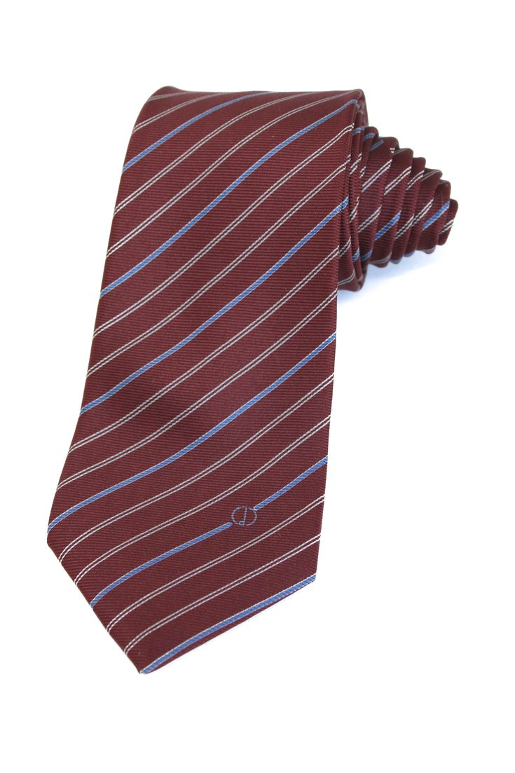 Silk necktie from Dunhill with striped print. In Burgundy, light blue, and light beige colors. The tie is in an excellent condition. Length: 144Cm. Width: 8cm.
