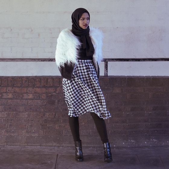 Get this look: http://lb.nu/look/6810640  More looks by Saima Chowdhury: http://lb.nu/saimachowdhury  Items in this look:  Al Madina Hijabs Black Scarf, Choies Faux Fur Jacket, Zara Black Polo Neck, Primark Check Skirt, H&M Leggings, Zara Boots   #hijab #fauxfur