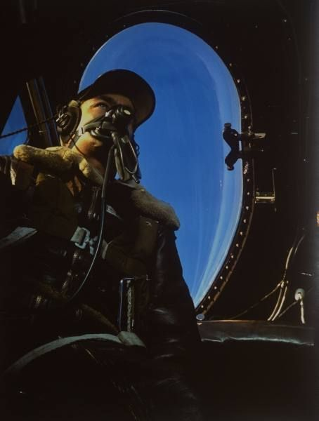 Fortune Color February 1942. Pilot in US mil. leather jacket wearing oxygen mask, sitting in plane cockpit (no caps) during WWII. | Date: 1942 | Photographer: Dmitri Kessel | LIFE archive - Hosted by Google