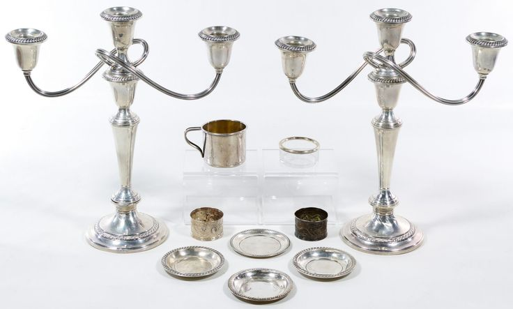 """Lot 86: Sterling Silver Hollowware Assortment; Ten items including two candleholders by Gorham, two Asian napkin rings, four coasters, a cup and sterling rimmed glass; most marked """"sterling"""", candleholders weighted"""
