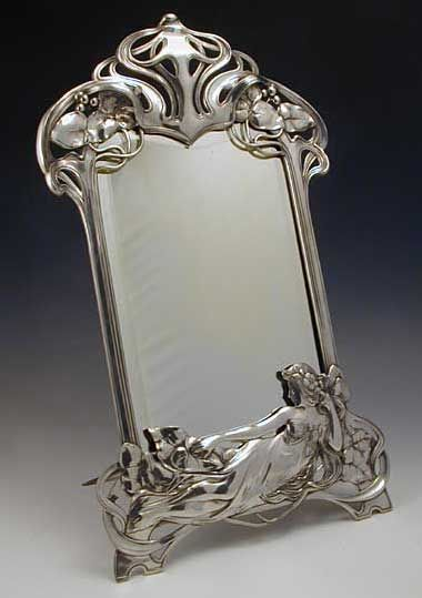WMF Pewter Mirror with Art Nouveau Figural Maiden Reclining. Description Polished pewter & bevelled glass mirror with Art Nouveau figural maiden. Country of Manufacture: Germany. Date: 1906