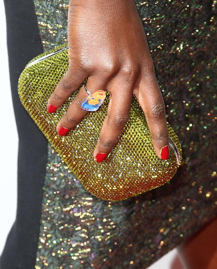"Lupita Nyong'o wearing a quirky Leroy's Place ""Grace Jones"" ring at the 2014 GLAAD Media Awards 