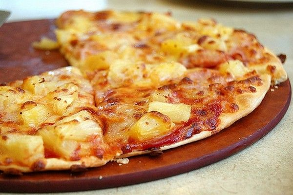 Home pizza with sausage and pineapple