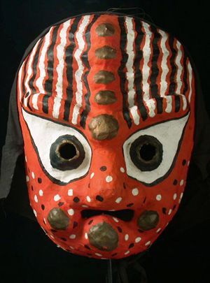 Orange Bongsan Mask    Hwanghae Province, Korea    13 inches, papier mache with black cotton hood