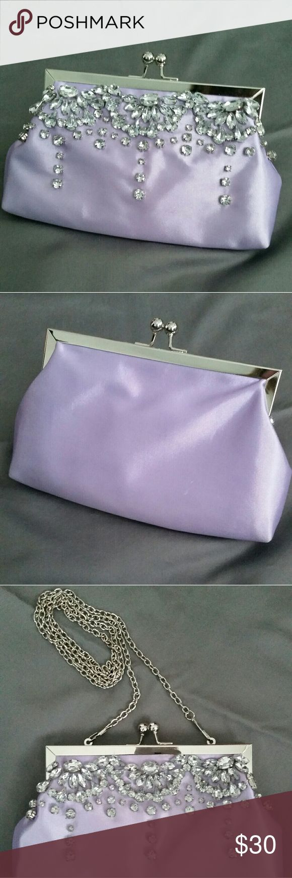 Charming Charlie RSVP convertible occasion bag Lavender/lilac colored clutch/shoulder handbag with rhinestones. Used once. No visible stains, rips, or tears.  ●Open to reasonable offers ●Willing to negotiate; feel free to press the offer button ●5% off when you bundle 3 items  ●Will ship out next day ●All items come from a pet and smoke free home Charming Charlie Bags Clutches & Wristlets