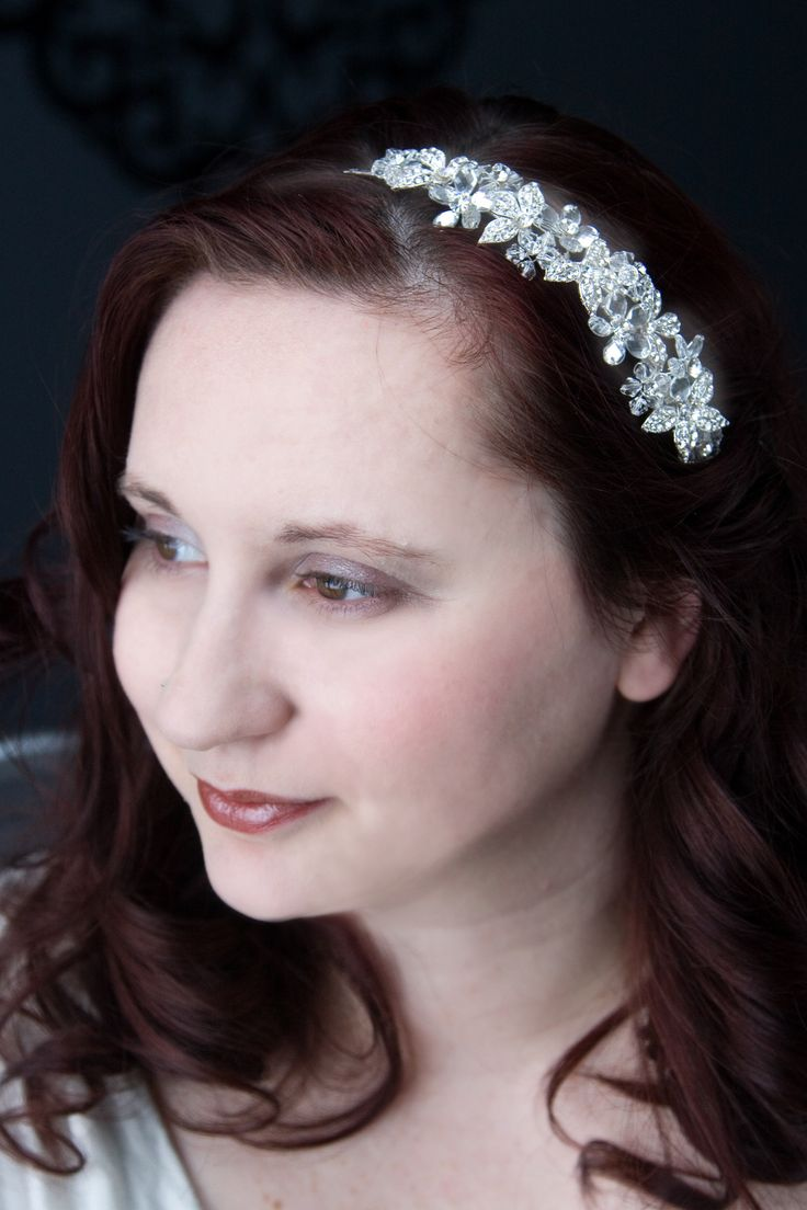 A sparkling bridal headband with flowers of checkerboard teardrop CZ, crystal bead flower and rhinestone encrusted metal flowers. This headpiece would be a great choice for a bride or for any special