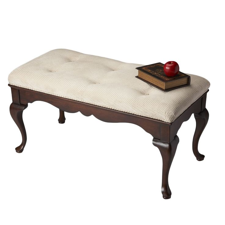 A Classic Styled Bench With A Fabric Button Tufted Seat
