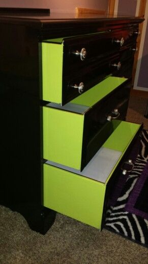 Black dresser with neon green drawers. My daughter loves this