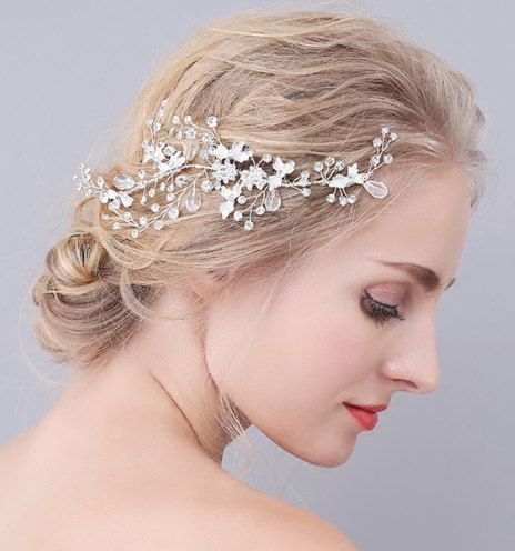 A stunning silver hair vine that incorporates sliver leafing, delicate vines and faux silver crystals to create a soft and feminine look for all occasions. The delicate hair piece is easy to fasten into the hair with one already attached hair slide. Its made with soft metal so its very flexible and easily adjustable to fit whatever style you opt for. This head piece is ready to ship and can ship worldwide.