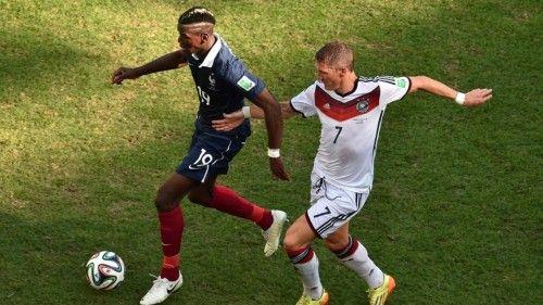 Paul Pogba France dribbles ball past Bastian Schweinsteiger Germany in the match France vs Germany Quarter Finals World Cup 2014 in Estadio Do Maracanã, Rio de Janeiro .. http://sdgpr.com/paul-pogba-bastian-schweinsteiger-world-cup-2014.html