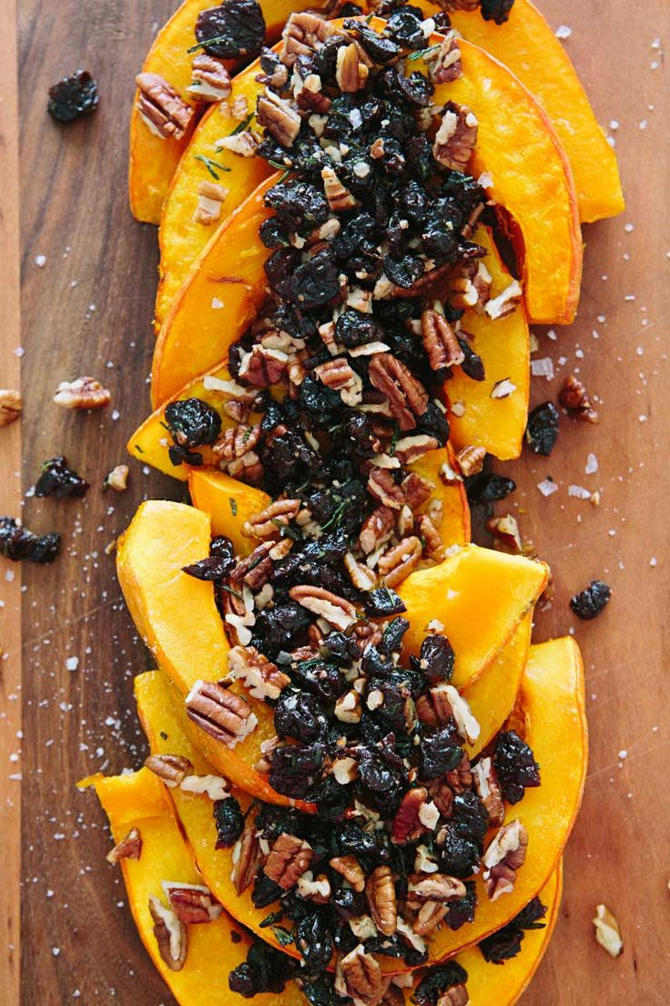 Roasted Red Kuri Squash + Tart Cherries - tart dried cherries that've been sautéed in butter with rosemary and then mixed with pecans. Yum.