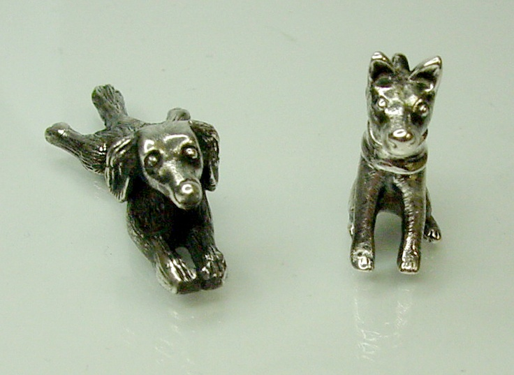 Hand crafted sterling silver puppy dogs made for their owners from photos.