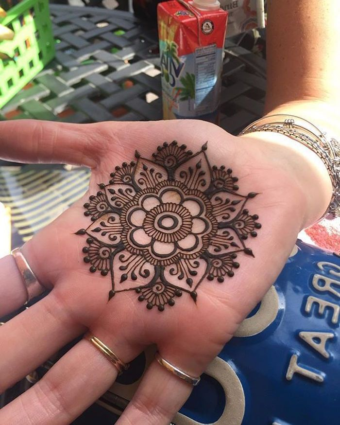 91e95ff8d henna hand tattoo designs, perfectly symmetrical flower mandala, painted  with brown henna, on the palm of a hand