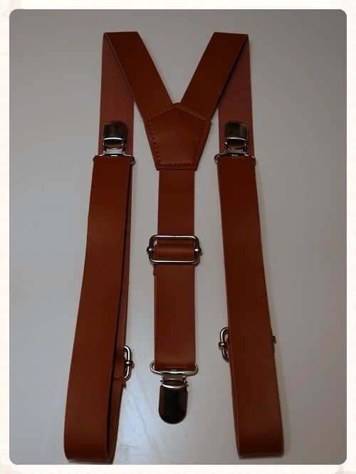 Men's / Grooms braces. Brown faux leather Y shaped braces. These braces make a great change from the traditional grooms wear. Only £7.50 each. www.picketfenceweddings.co.uk