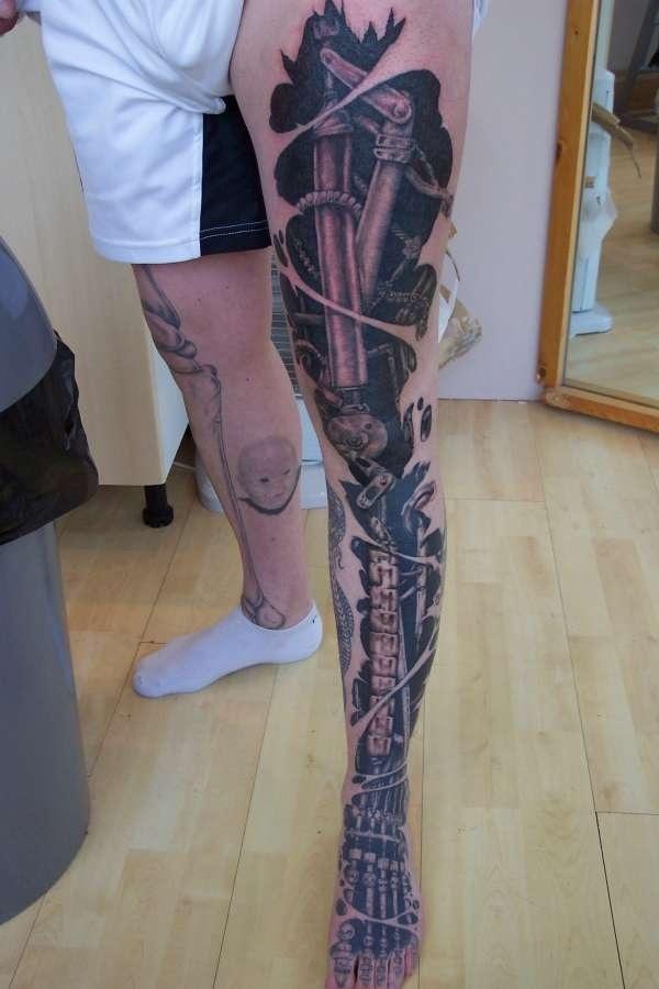 Cool biomechanical leg tattoo...