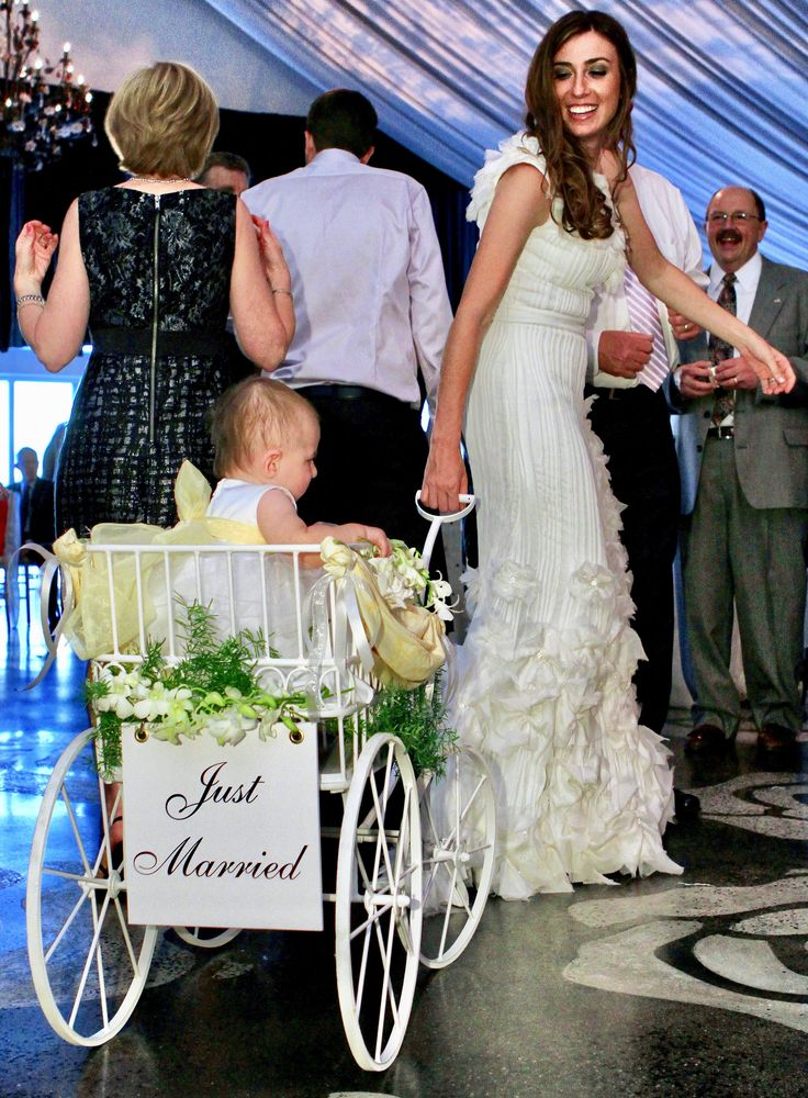 A whimsical idea for flower girl or ring bearer. A delicate, white, wire wagon is a great option to include toddlers too young to walk in your wedding.  Marie Labbancz Photography.