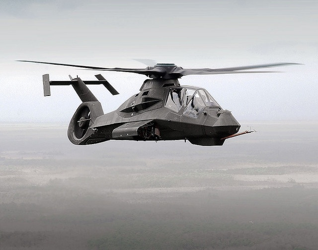 """The Boeing """"Stealth"""" Sikorsky RAH-66 Comanche.    Armament 1× 20 mm XM301 three-barrel cannon mounted in a Turreted Gun System with a 500 round capacity. Internal bays: 6 Hellfires or 6 Stingers (ATAS) or 24 Hydra 70 2.75 in (70 mm) air-to-ground rockets. Optional stub wings: 8 Hellfire, 16 Stinger or 56 x Hydra 70 air-to-ground rockets."""