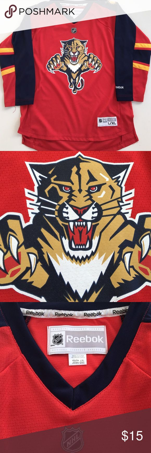 Youth NHL PANTHERS hockey jersey Size L/XL Youth PANTHERS hockey jersey. Printed Panther crest on chest and shoulders. Very nice condition but has some pulls on left sleeve. Reebok Shirts & Tops