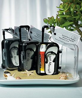 Mini travel trolleys as favors fit the theme of a destination wedding, as low as $10.38