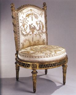 A chair made for Marie Antoinette, covered in floral silk.