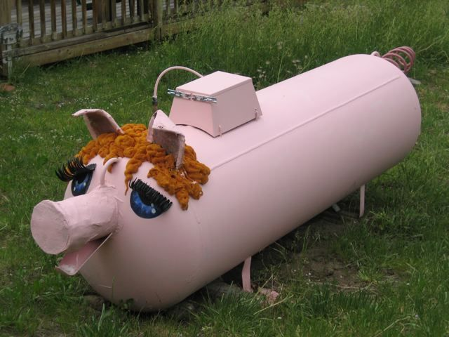 I have been trying to think of a way to dress up the ole' propane tank and here it is!  Think of the possibilities!