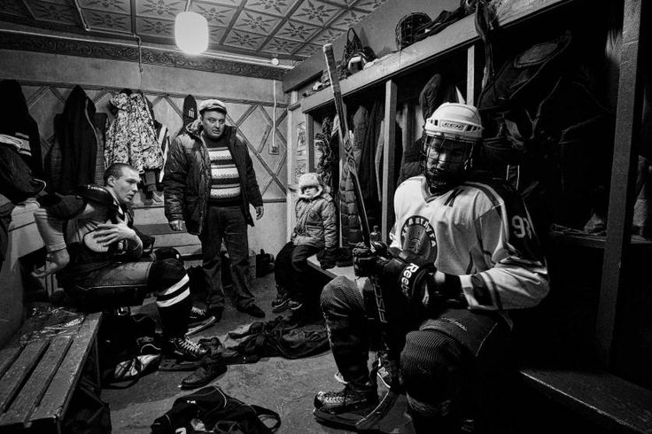 Sports, 1st prize stories. Players in the locker room of HC Vetluga at halftime, Vetluga, Russia, Feb. 19, 2015.