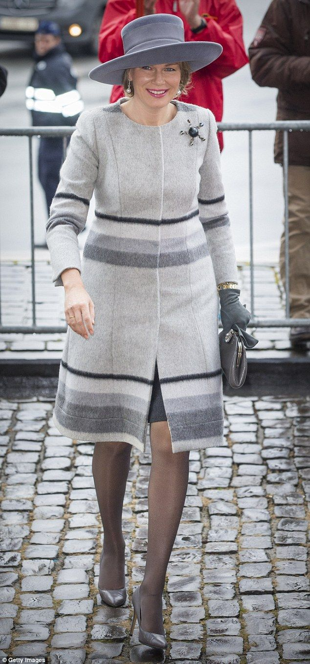 Queen Mathilde stepped out in top to toe grey for a mass to commemorate deceased members o...