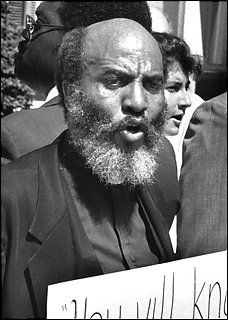 The Rev. James Bevel demonstrates outside U.S. District Court during the trial of Marion Barry in 1990.