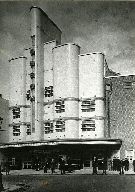 Odeon Deptford/London. Beautiful Art Deco (even with the left not matching the right side). Opened in 1938; suffered bomb damage & closed in 1944; repaired & reopened in 1951. Closed in 1970 & sold to development company in 1973. Languished until demolition in 1988 for shops & homes construction.