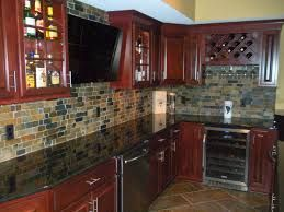 Image result for slate backsplash with blue pearl granite countertops cherry cabinets
