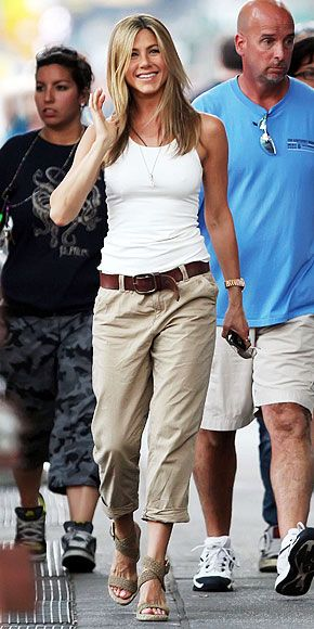Jennifer Anniston. Loose khakis simple tank and wedges! Effortless... Now where can I find those pants!