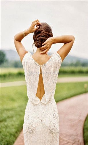 What an elegant back this vintage style dress has... Loving the bead and crystal detail too.