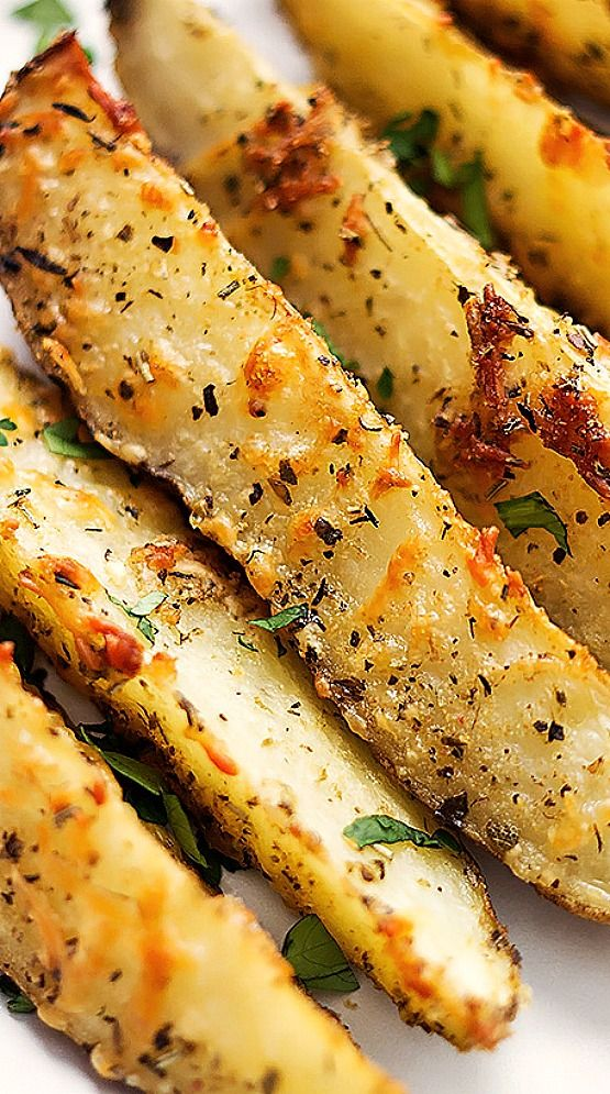 Garlic and parmesan seasoned potato wedges oven roasted to golden tender perfection!!
