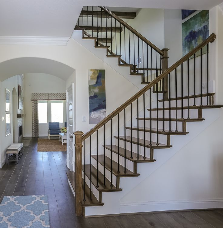 Gehan Homes Stairway - Medium Hardwood Tread, White Risers, U-Shaped Staircase, Medium/Dark Hardwood Flooring