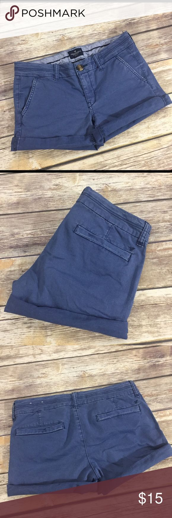 """AEO Midi navy Blue Chino Shorts American Eagle Outfitters navy blue Chino """"Midi"""" Shorts in size 4. Made of 97% cotton and 3% elastane. Very good condition with no flaws. Approximate inseam with legs unrolled is 5"""". ⚓️No trades or holds. I negotiate only through the offer button. Any measurements listed are approximate since I am not a seamstress. 🚭🐩T1 American Eagle Outfitters Shorts"""