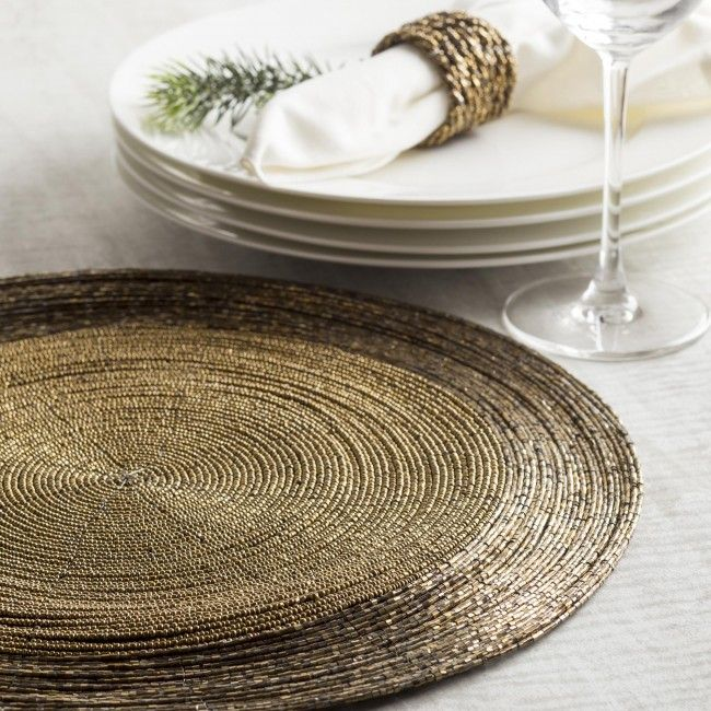 Add glimmer and glitz to your elegant table setting with this beautiful beaded, round placemat.